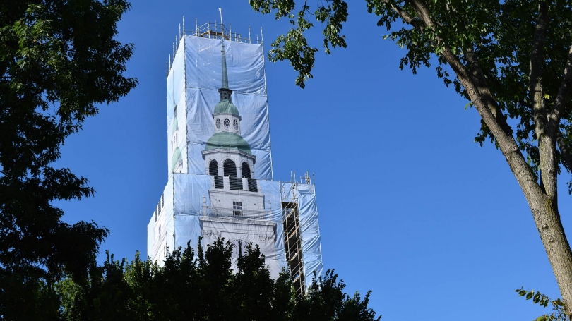 A scrim covers Baker Tower during its renovation