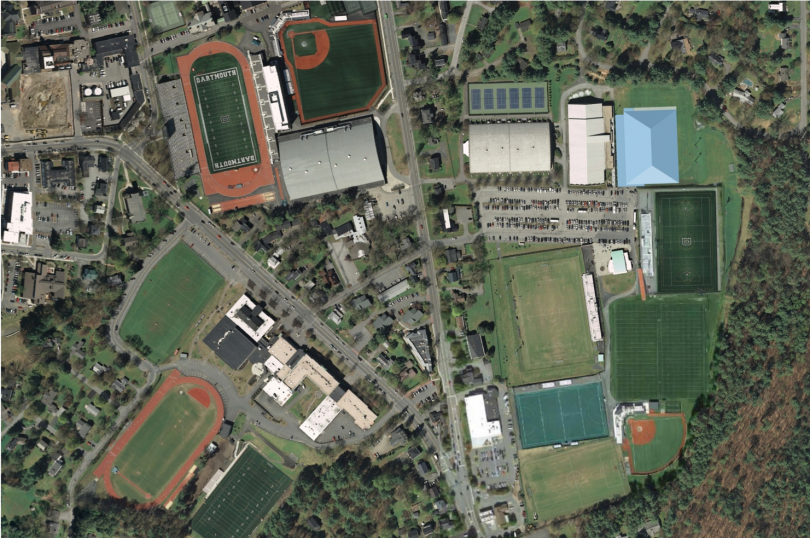 An overhead view of athletic fields and buildings shows the future location of the practice facility
